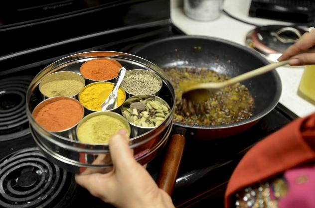 Jasjit Kaur Singh, an Indian chef, cooks <em>kaala channa,</em> a traditional spicy Sikh dish. A psychologist says that children who grow up in cultures with lots of spicy food are taught to like spice early on.