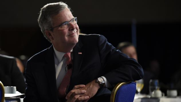Former Florida Gov. Jeb Bush listens before a Nov. 20 speaking engagement in Washington.