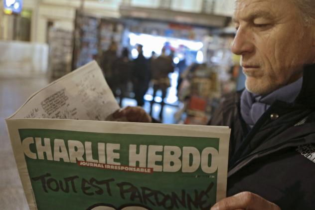 Jean Paul Bierlein reads the latest issue of Charlie Hebdo outside a newsstand in Nice, southeastern France, on Wednesday.