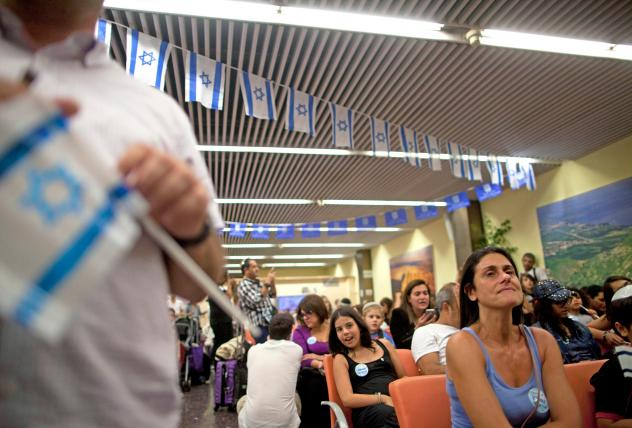 An estimated 400 new French Jewish immigrants attended a welcoming ceremony after arriving on a flight from France to Tel Aviv, Israel in July 2014.