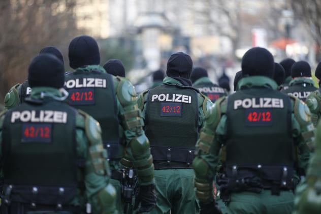 German police officers gather in preparation for a demonstration by members of LEGIDA, the Leipzig arm of the anti-immigrant movement PEGIDA.
