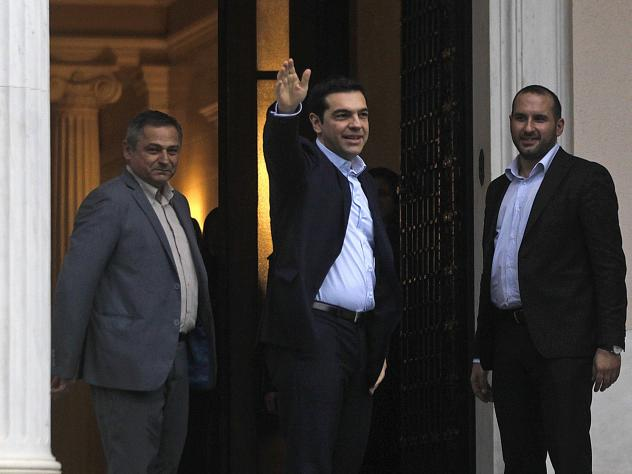 Newly sworn-in Greek Prime Minister Alexis Tsipras enters his new offices in Athens on Monday.