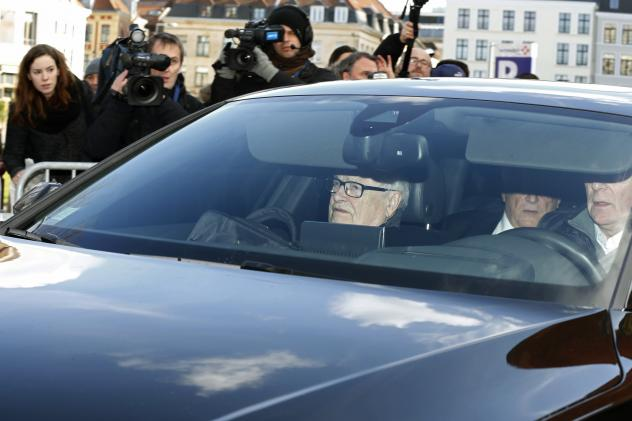 """Former IMF head Dominique Strauss-Kahn (partially seen in backseat of the car) arrives for the start of a trial in the """"Carlton Affair,"""" in Lille, France, on Monday."""