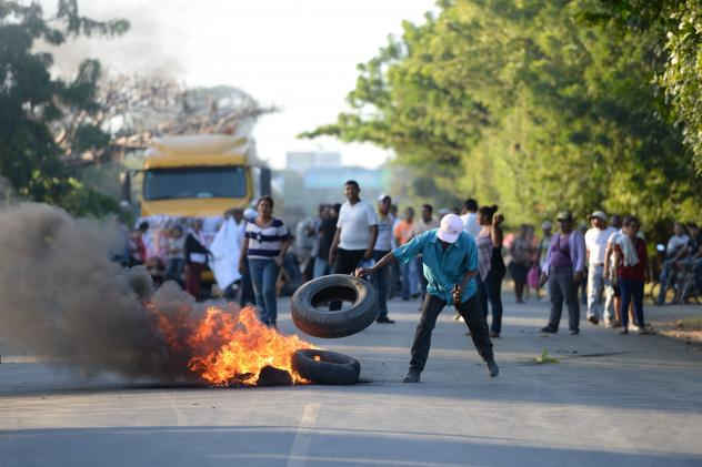 Protesters burn tires to demonstrate against the inter-oceanic canal in Rivas, Nicaragua, on Dec. 22, 2014. HKND Group, a Chinese company, began work on a $50 billion canal, an ambitious rival to the Panama Canal.