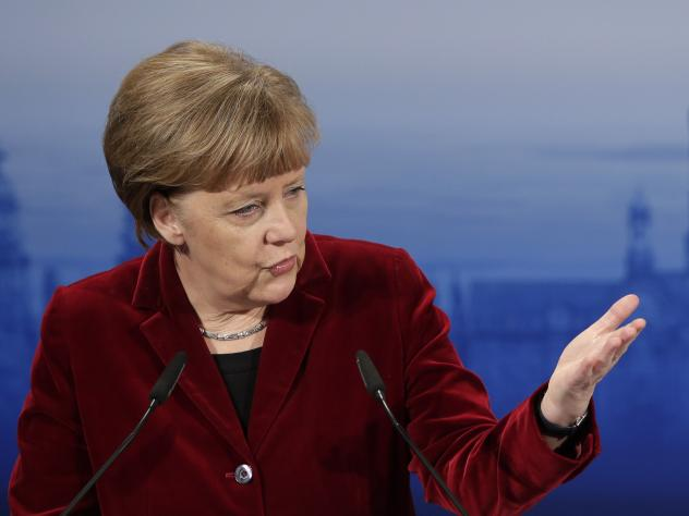 German Chancellor Angela Merkel gestures during her speech at the Munich Security Conference in Munich, Germany on Saturday.