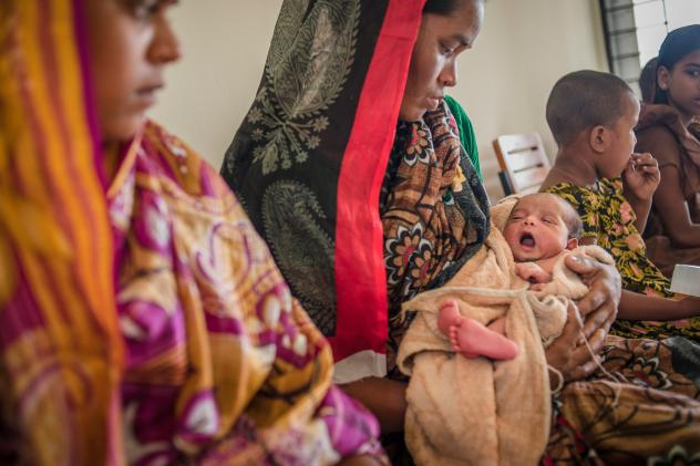 Rong Mala, 30, with her 6-day-old child Rakhal, who recently had a postnatal check up at the government clinic built in partnership with Save the Children in eastern Bangladesh.