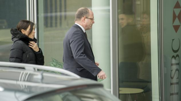 Geneva Attorney General Olivier Jornot, center, leaves HSBC offices during a search of the private bank Wednesday. Swiss prosecutors have started searching offices of the Geneva subsidiary of HSBC bank in an inquiry relating to alleged money-laundering.