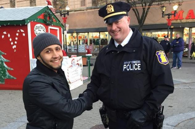 "Yonkers community activist Hector Santiago demonstrates the ""stop-and-shake"" with Lt. Pat McCormack of the Yonkers Police Department. The idea, Santiago says, is to get people to introduce themselves to cops on the street."
