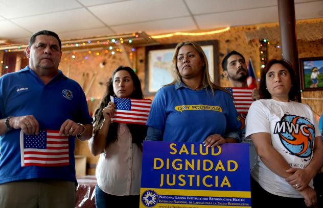 People in Miami protest the Texas district judge who on Tuesday temporarily blocked the implementation of President Obama's executive actions on immigration.