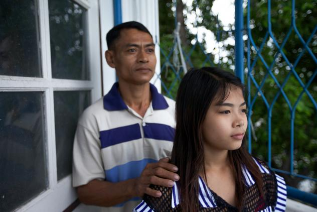 Thazin Mon Htay, 14, has scars on her arms from infections she caught while peeling shrimp for 16 hours a day, seven days a week. She and her father were able to gain their freedom from the shrimp shack after their relatives paid off their debts.