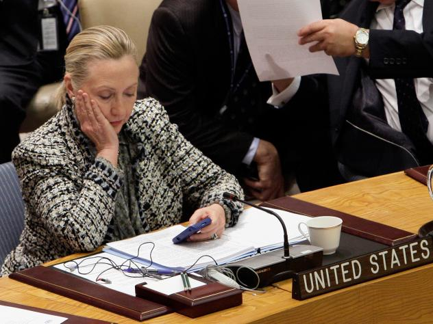 U.S. Secretary of State Hillary Rodham Clinton checks her mobile phone in March 2012 after her address to the Security Council at United Nations headquarters. While she's asked the State Department to quickly release her emails from her tenure as secreta