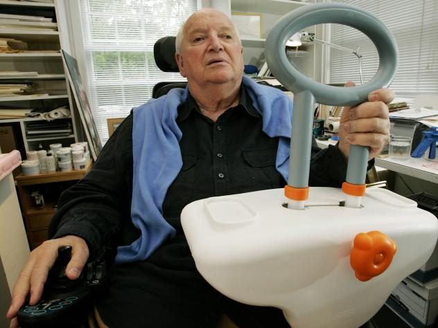 Michael Graves sits in his Princeton, N.J., studio holding a bathtub handle he designed to help the handicapped and elderly, on Sept. 11, 2009. Graves died today at age 80.