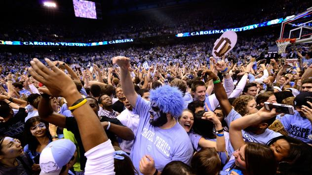 University of North Carolina, Chapel Hill basketball fans storm the court after a win over Duke in 2014.
