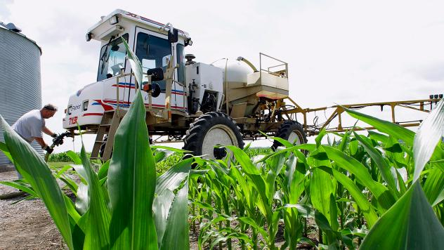 Central Illinois corn farmer Jerry McCulley refills his sprayer with the weedkiller glyphosate on a farm near Auburn, Ill. A new assessment of the chemical finds that the (uncertain) risks mainly affect the people who work with it or who come in direct c