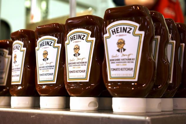 Commemorative ketchup bottles with portraits of Warren Buffett are seen at the exhibition of Berkshire Hathaway companies at the annual meeting in Omaha, Neb., on May 3, 2014. Kraft Foods said it will merge with ketchup maker H.J. Heinz Co., owned by 3G