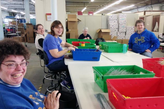 In sheltered workshops, people with disabilities are paid according to how quickly they're able to complete tasks. Usually, they make well below minimum wage. At Production Unlimited, they make office supplies, safety equipment and binders for the U.S. A