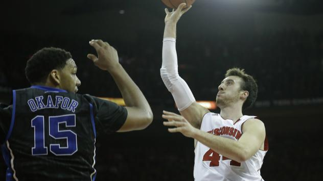 Frank Kaminsky of the Wisconsin Badgers will face off against the Duke Blue Devils' Jahlil Okafor in Monday night's NCAA title game. When the teams played in December, Duke won 80-70.