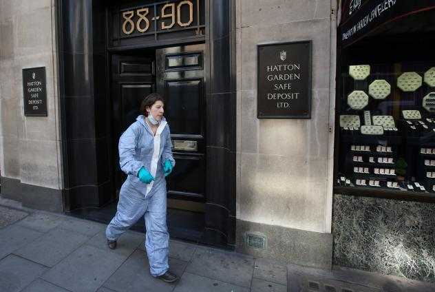 In an elaborate crime that went undetected until Tuesday morning, thieves broke into a safe deposit center used by many jewelers. Here, a woman believed to be a police forensics officer emerges from the building.