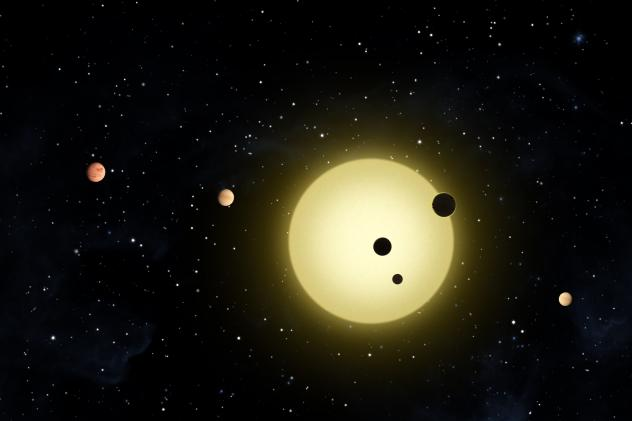 This artist rendering shows Kepler-11, a sun-like star around which six planets orbit. A planet-hunting telescope is finding whole new worlds of possibilities in the search for alien life, including more than 50 potential planets that initially appear to