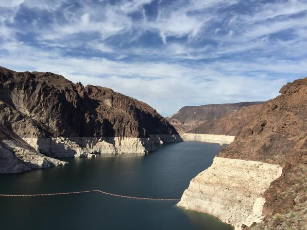 Dropping water levels reveal larger islands in Lake Mead compared with a picture on an interpretive sign overlooking the lake in the Lake Mead National Recreation Area in Nevada. A 14-year drought has caused the water level in the reservoir to shrink to