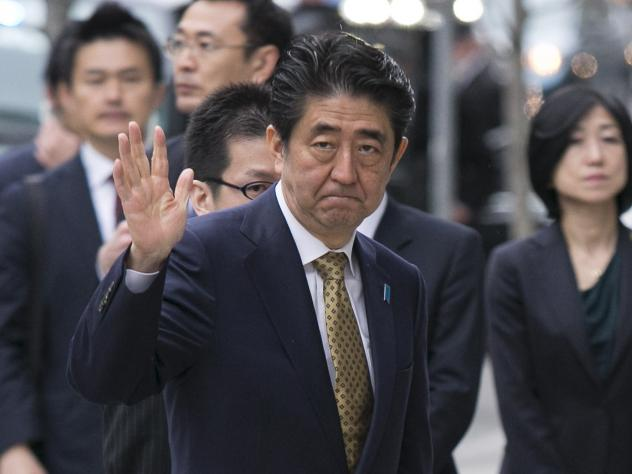 Roughly 250 Japanese demonstrators take part in a march through downtown Tokyo on Saturday, protesting Prime Minister Shinzo Abe's policies on strengthening Japan's national defense.