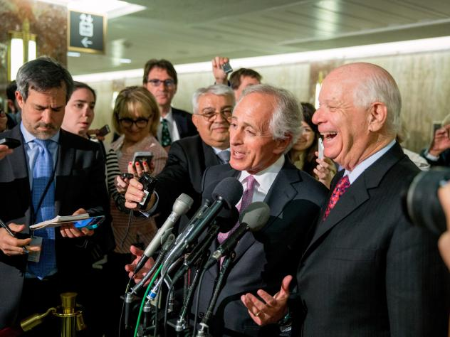 Senate Foreign Relations Committee Chairman Sen. Bob Corker, R-Tenn., center, and the committee's ranking member Sen. Ben Cardin, D-Md., right, were all smiles April 14 after the committee passed an agreement on oversight of Iran negotiations. But the bi