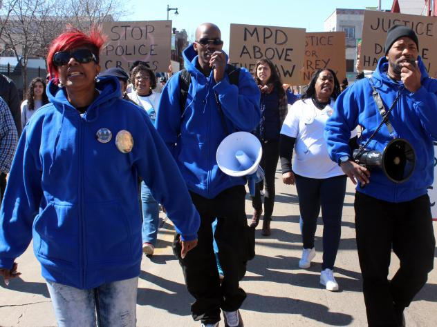 Maria Hamilton, left, marches in Milwaukee with her sons on April 30th in remembrance of her son Dontre, who was shot and killed by a now-former police officer in a park last year. Hamilton founded Mothers for Justice United, which planned a march on Was