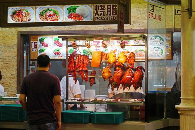 "A food market in Singapore in 2012. The U.S. government says that American farmers can help ""fill the void"" being created by rising demand for meat in countries like Singapore through the Trans-Pacific Partnership."