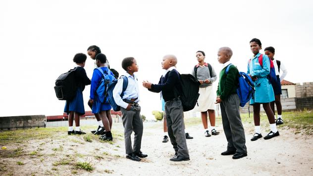 Kids in Cape Town socialize as they walk to school. Children in South Africa often don't get to play outside by themselves because of the high rate of violent crimes in some areas.