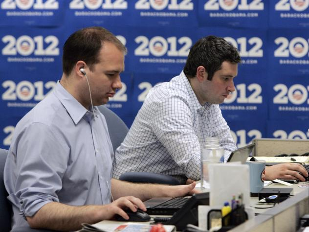 A quick staff-up and a fast-paced money grab are common to both startups and campaigns. Here, staffers work on computers during a tour of U.S. President Barack Obama's re-election headquarters May 12, 2010 in Chicago.