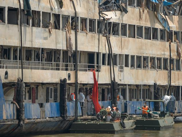 Rescuers work in the hull of the upright ship Eastern Star to launch rescue work in the section of Jianli on the Yangtze River, central China's Hubei Province, on Saturday.