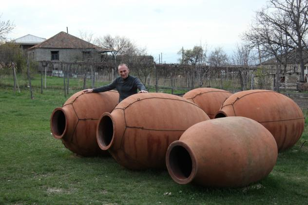Winemaker Iago Batarshvili makes wine in clay vessels called <em>qvevri,</em> which he buries underground and fills with white grapes. There are no barrels, vats or monitoring systems for this ancient Georgian method, which is helping drive sales. Batars