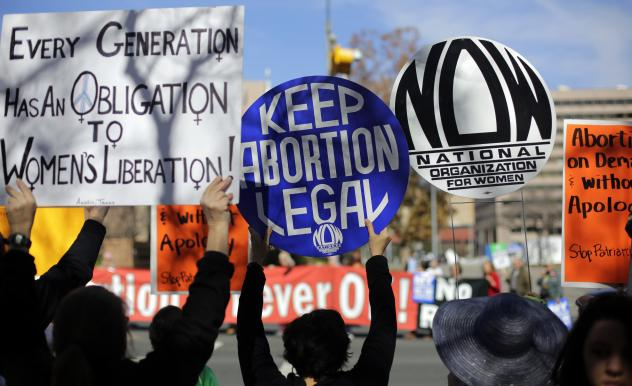 Abortion-rights supporters (foreground) try to disrupt an anti-abortion march to the Texas Capitol during a Texas Rally for Life on Jan. 24 in Austin, Texas.