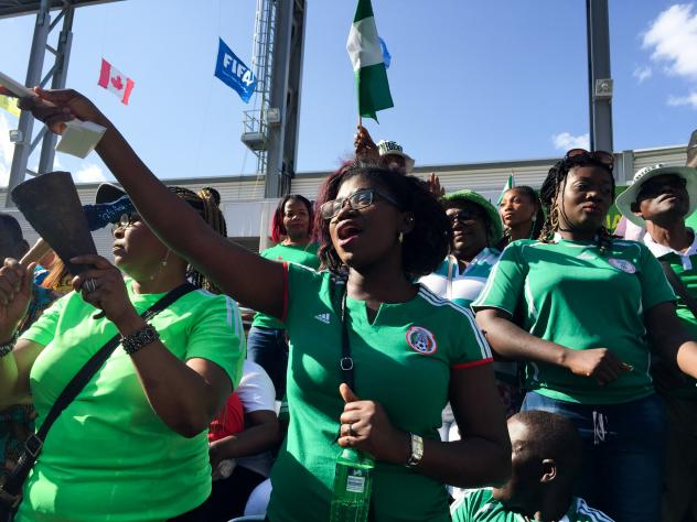 Nigerian fans stand and deliver cheers at a match against Australia, played during the Women's World Cup in Winnipeg, Canada.