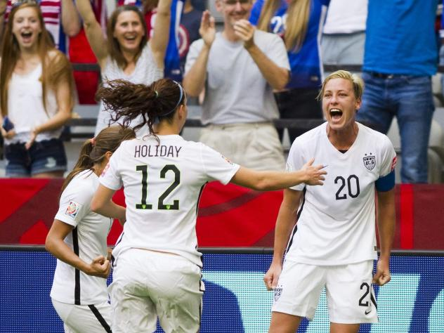 Abby Wambach of the U.S., from right, celebrates with teammates Lauren Holiday and Tobin Heath after scoring against Nigeria at the end of the first half Tuesday during the FIFA Women's World Cup in Vancouver, Canada.