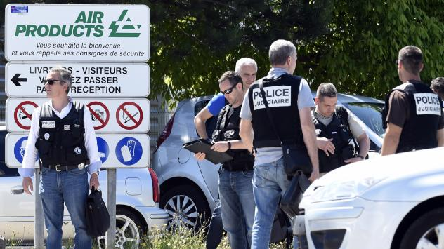 French security and emergency services gather at the entrance of the Air Products factory in Saint-Quentin-Fallavier, near Lyon, on Friday.