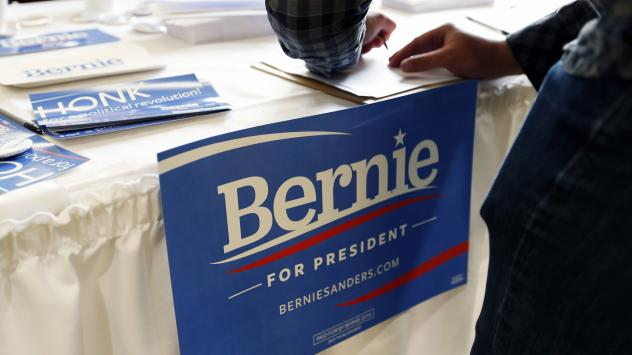 A supporter registers for a town hall meeting Thursday in Rochester, Minn.