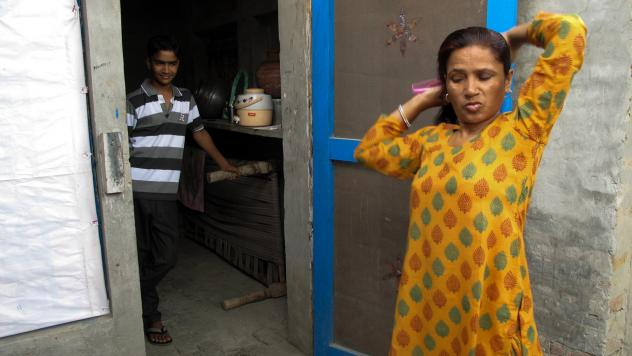Saroj listens to the complaints and concerns of other cooks and kitchen help during a union meeting.