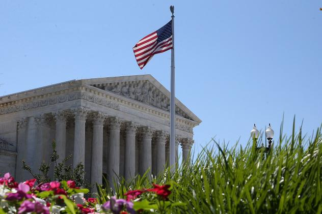 An American flag flies over the U.S. Supreme Court June 29, 2015 in Washington, D.C. This past term, the liberal position won in 19 of the 26 closely-divided ideological cases and eight out of 10 of the most important ones.