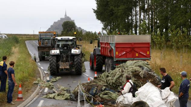 Farmers blocked the road to Mont Saint-Michel, the tourist attraction  seen in the distance.