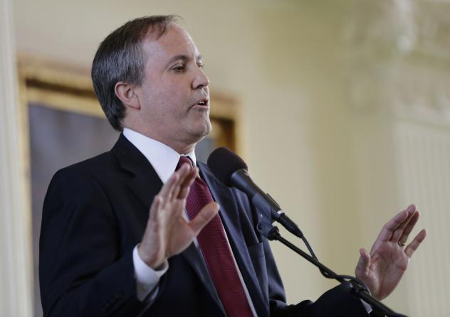 Texas Attorney General Ken Paxton, seen hear at his January swearing-in ceremony, has asked a federal judge to dismiss the lawsuit.
