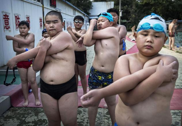 At a camp for overweight children in Beijing, students stretch after taking a swim.