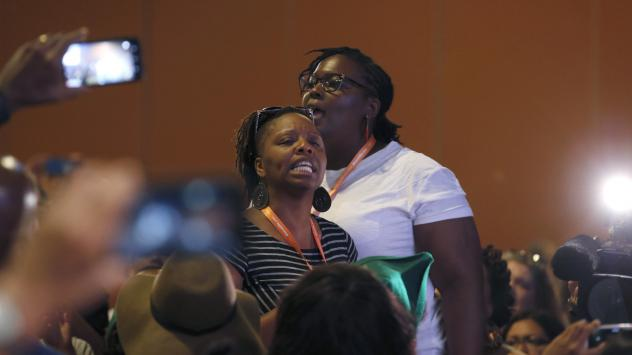 """Black Lives Matter activists confronted Democratic candidates Martin O'Malley and Bernie Sanders at a Netroots Nation event earlier this month. O'Malley used the phrase """"all lives matter"""" twice, which he later apologized for."""