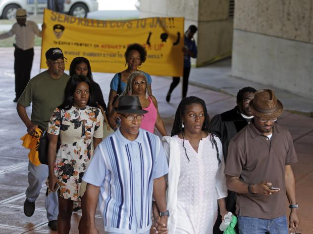 Protesters arrive at the Mecklenburg County Courthouse on the first day of the trial of former Charlotte-Mecklenburg police Officer Randall Kerrick in Charlotte. Kerrick is charged with manslaughter in the shooting death of Jonathan Ferrell.