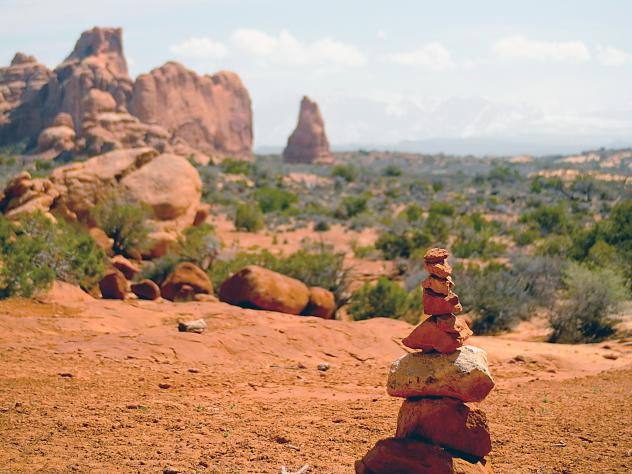 A cairn marks a trail in Arches National Park in Utah. Some build the piles as a meditative exercise, but their proliferation has infuriated some other nature lovers.