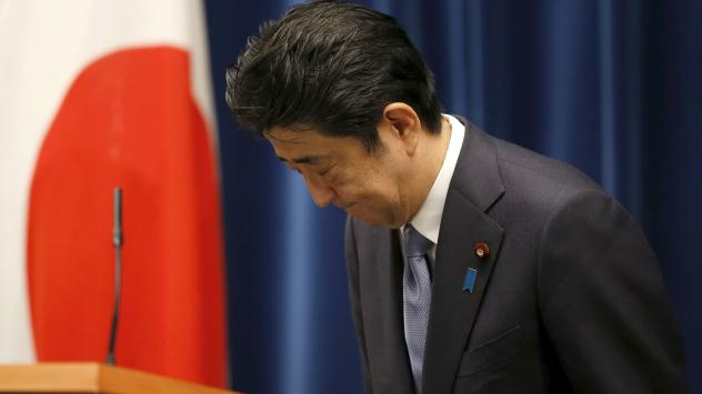 Japanese Prime Minister Shinzo Abe bows after delivering an address marking the 70th anniversary of World War II's end for his country. Abe noted Japan's continued grief over the war, but he also said future generations shouldn't be compelled to apologiz