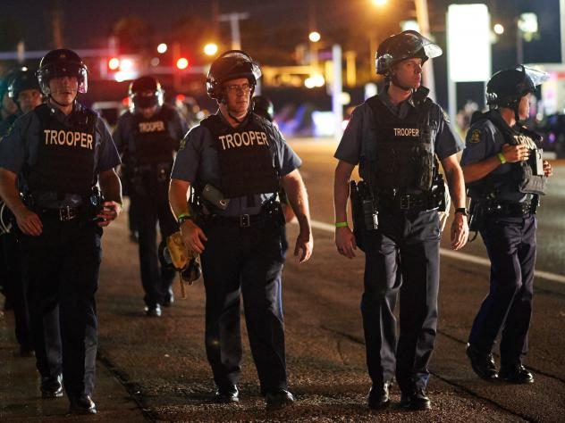 Police patrol Ferguson, Mo., on Monday night after St. Louis County issued a state of emergency.