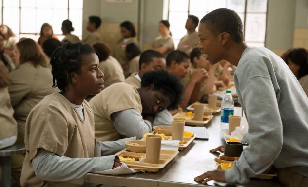 Uzo Aduba and Samira Wiley in <em>Orange Is the New Black, </em>one of the many series now delivered in one big bundle.