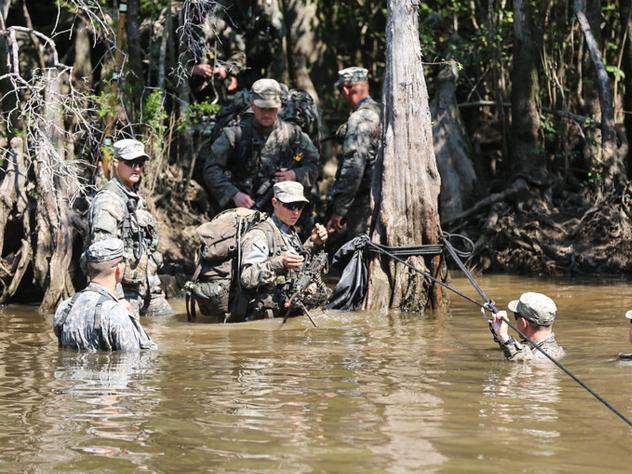 Two women will be among the soldiers who will graduate Friday from Army Ranger training. The Swamp Phase, seen here on Aug. 6, is part of the rigorous course.