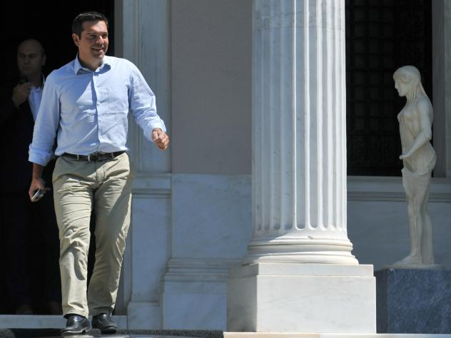 Greek Prime Minister Alexis Tsipras leaves his office in Athens on Thursday, hours before he announced he would step down as prime minister amid fresh elections set for Sept. 20.